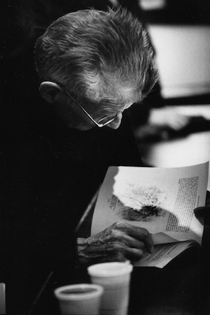 Samuel Beckett looking at a drawing by long-term friend Avigdor Arikha. London, 1984
